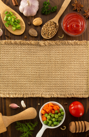herbs and spices on wooden background Reklamní fotografie