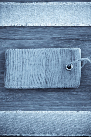 jeans at wooden texture background photo