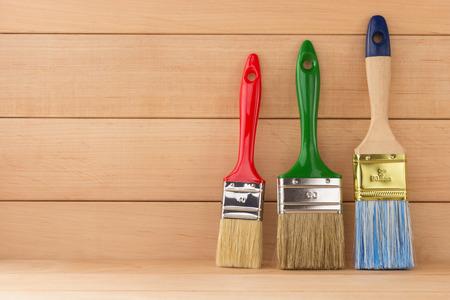 paint brush  on wooden background photo