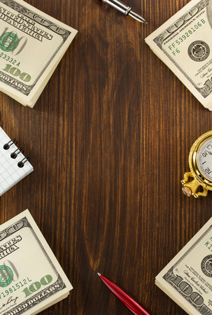 dollars money banknotes on wooden background photo
