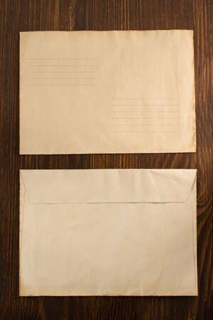 old envelope: old envelope on wooden background