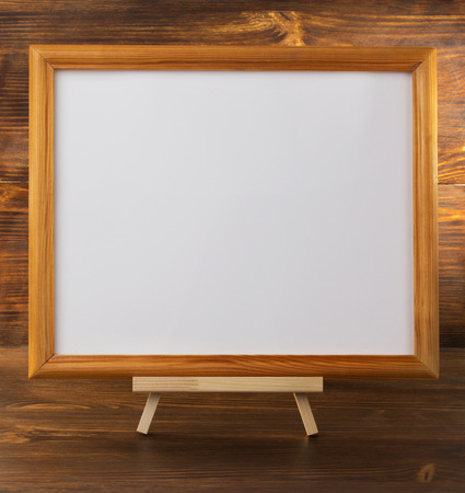 paint frame on wooden background photo