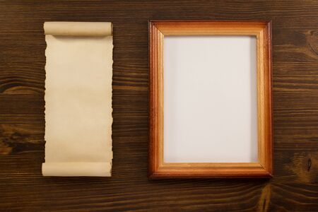scroll border: photo picture frame on wooden background Stock Photo