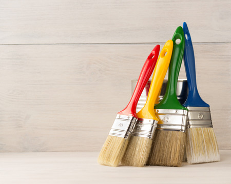 red paint: paint brush  on wooden background Stock Photo