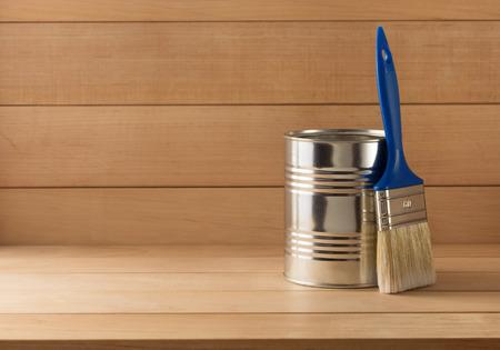 paint bucket: paint bucket and paintbrush  on wooden background Stock Photo