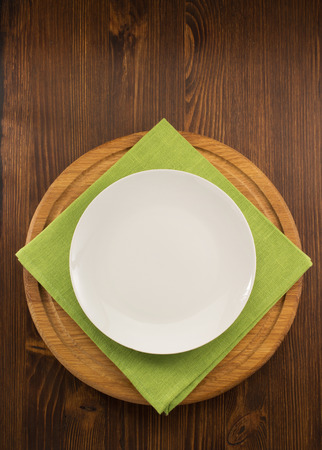 plate knife and fork on wooden background photo