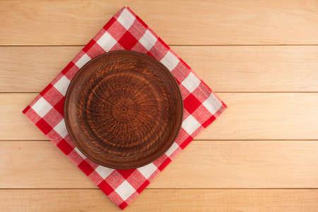 kitchen utensils at cloth napkin on wooden background photo