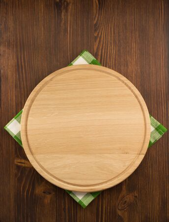 napkin cloth and cutting board on wooden background photo