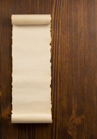 scroll design: parchment scroll on wooden background