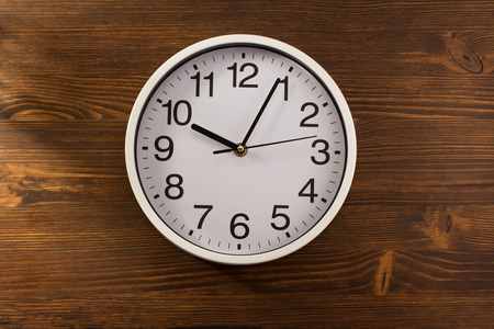 morning noon and night: wall clock on wooden background