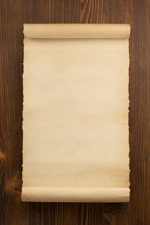 scroll: parchment scroll on wooden background