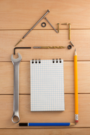 housebuilding: engineering concept on wooden background
