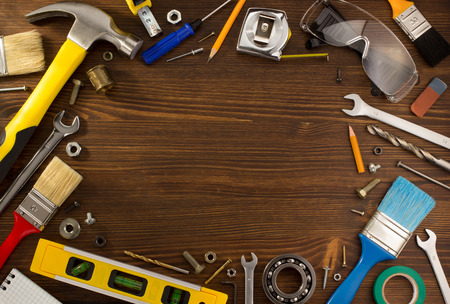 set of tools and instruments on wooden background photo