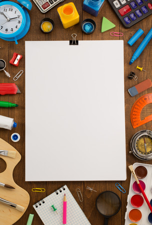 school supplies and paper on wooden background Archivio Fotografico