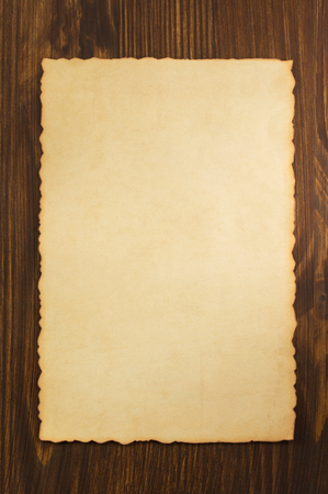 paper parchment on wooden background