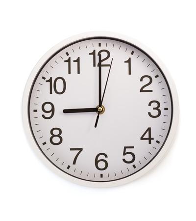 reloj pared: reloj de pared aisladas sobre fondo blanco Foto de archivo
