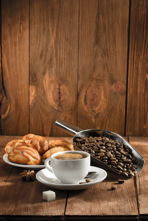 seeds coffee: cup of coffee on wooden background