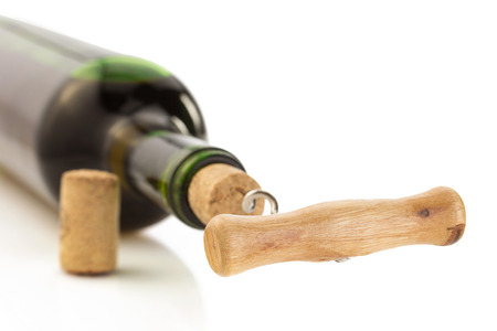uncork: corkscrew and wine bottle isolated on white background