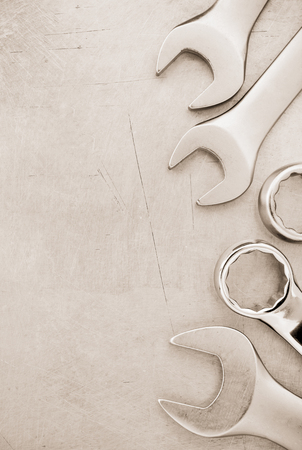 old tools: wrench tools at metal background