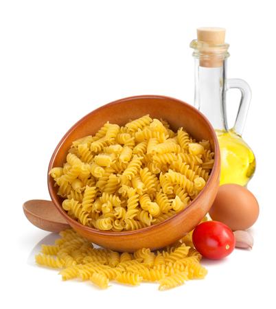 pasta: pasta fusilli isolated on white background