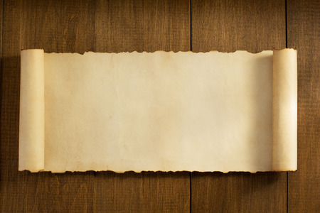 vintage background paper: parchment scroll on wooden background