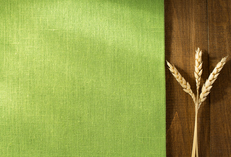 ears of wheat on wooden background Banco de Imagens