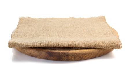 white napkin: sack burlap napkin at cutting board on white background Stock Photo