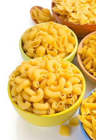 plato del buen comer: raw pasta in bowls isolated on white background Foto de archivo