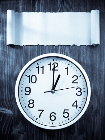 back in an hour: wall clock on wooden background