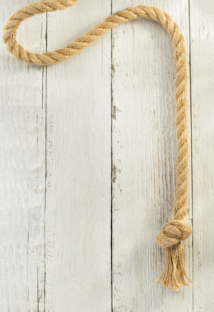 natural rope: ship rope on wooden background