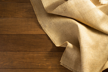 hessian: burlap hessian sacking on wooden background