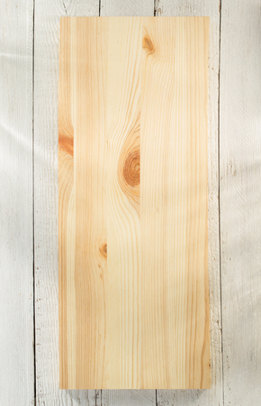 price cutting: board panel on wooden background