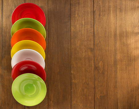 saucers: set of saucers on wooden background
