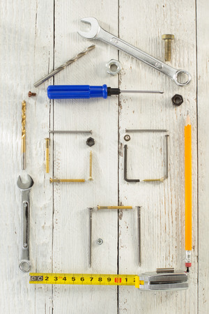 housebuilding: tools and instruments on wooden background Stock Photo