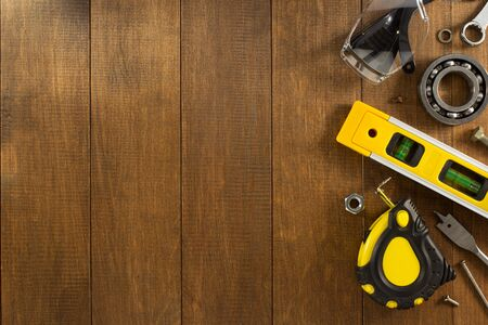 hardware: work tools and instruments on wooden background