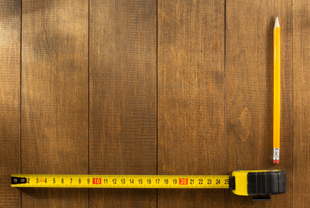 black wood texture: tape measure and pencil on wooden texture Stock Photo