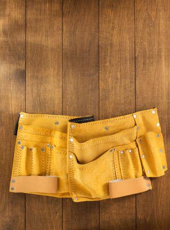 tool belt on wooden background