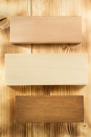 price cutting: board panels on wooden background
