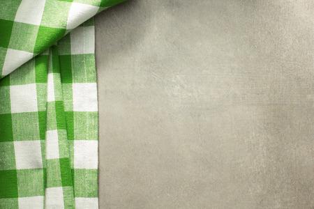 grunge cutlery: cloth napkin on old background