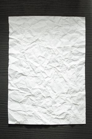 wrinkled paper: wrinkled paper at wooden background
