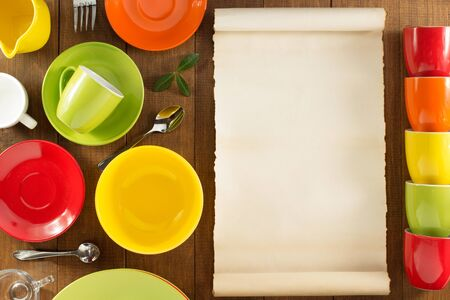 scroll: ceramic dishes set on wooden background Stock Photo