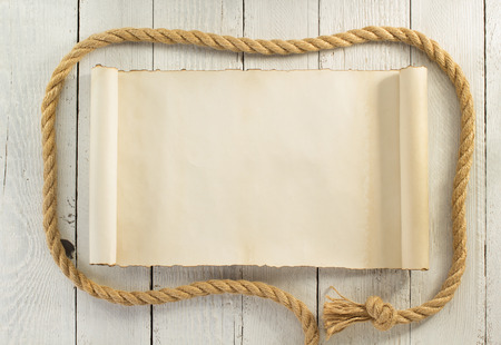 rope border: ship rope on wooden background