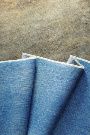 blue grey coat: blue jeans texture on background Stock Photo