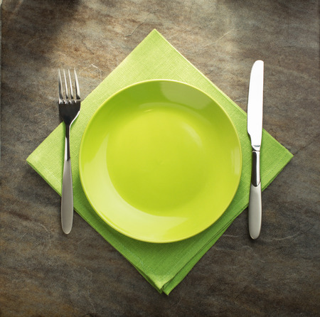 forks: plate, knife and fork on napkin cloth Stock Photo