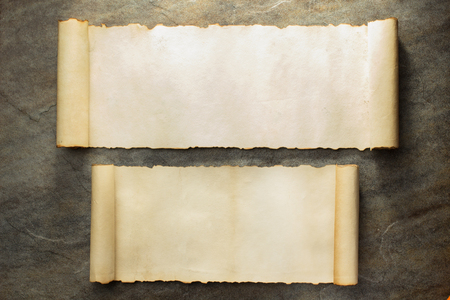 scroll border: parchment scroll on stone wall background