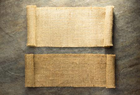 背景テクスチャの黄麻布のヘシアン解任 写真素材