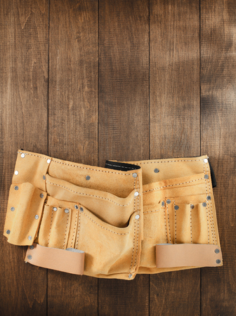 suede belt: tool belt on wooden background