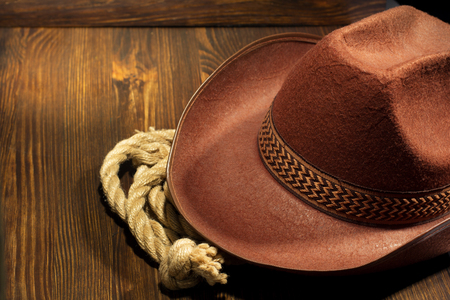 brown leather hat: cowboy hat on wooden background