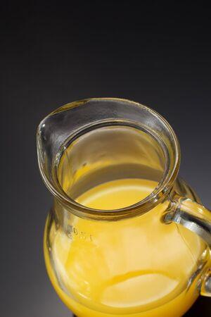 pitcher: orange juice in glass pitcher
