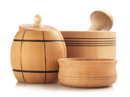 a jar stand: wooden tableware isolated on white background